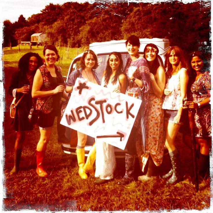 hippy wedding festival picture. wellies, headband, campervan, field, mud, bride