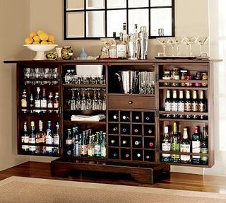 Modine Bar from Pottery Barn...hidden wheels, a built-in drip tray and storage for tons of booze and bartending accessories!  Love it!  -  alcademics.com
