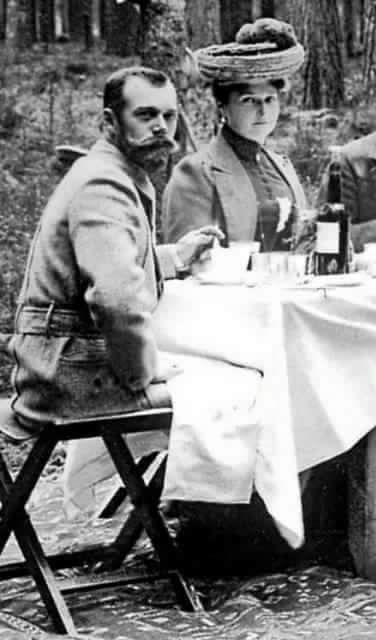 "Tsar Nicholas ll of Russia and Empress Alexandra Feodorovna of Russia in Poland dining after a hunt. ""AL"""