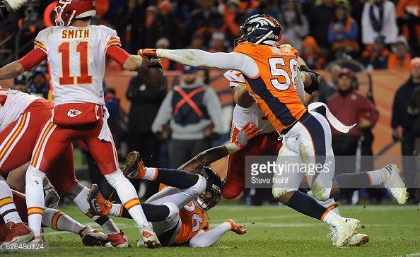 News Photo : Denver Broncos linebacker Von Miller gets a hand...