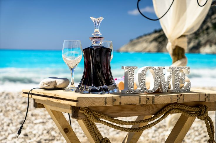Love sign in wooden ceremony table - suitable for beach wedding - http://www.kefaloniawedding.com/ #beachwedding #weddingingreece #kefalonia #mythosweddings