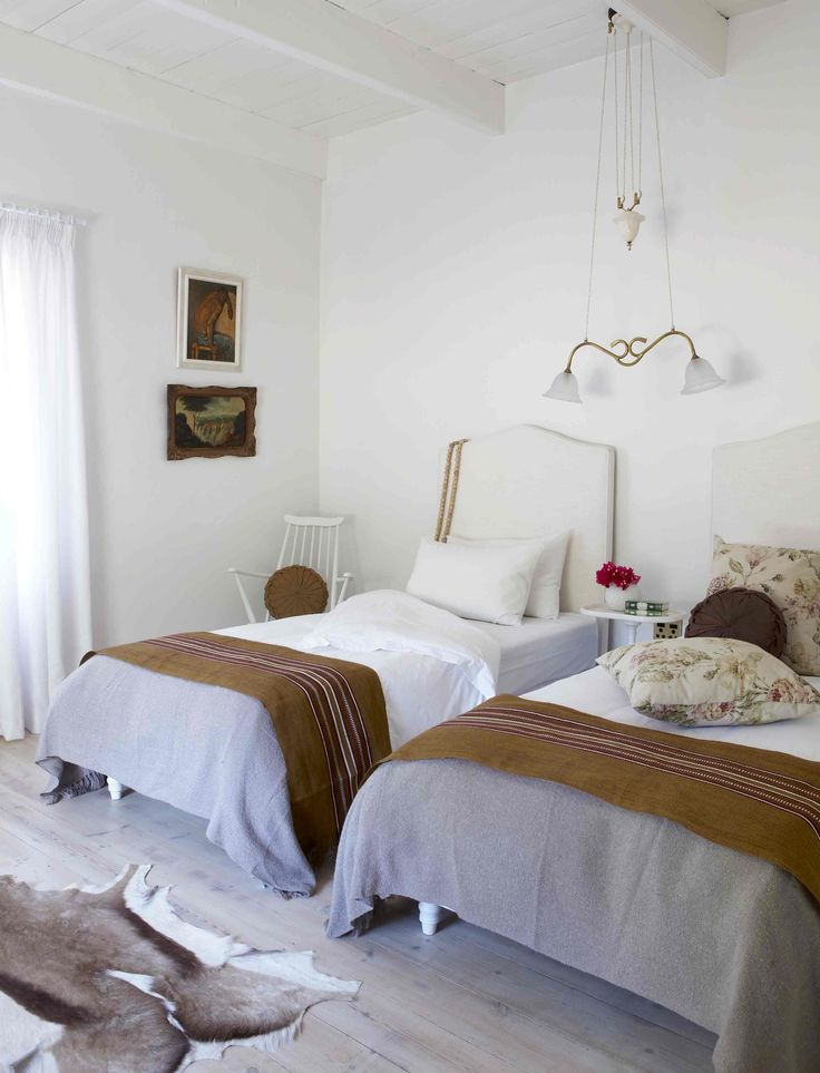 Guest bedroom - throws from Madwa. Victorian light fitting. Interiors by Jean-Pierre de la Chaumette.