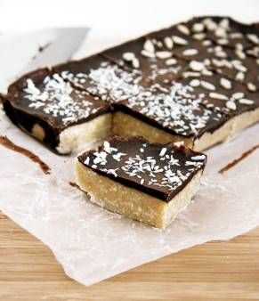 Carob Covered Coconut Bar Although this bar recipe has a few more steps, it's worth the extra effort. The bottom layer is made with coconut butter, while the top is carob powder (a healthier alternative to cacao powder). The combination of the two layers makes for a heavenly bar that will make you feel like you are eating a dessert.