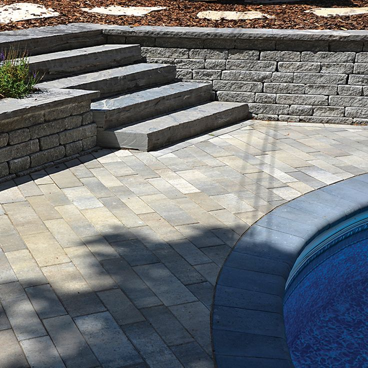 Poolside landscape. Project application using Presidio pavers. Color: Presidio Champagne by Oaks Landscape Products.