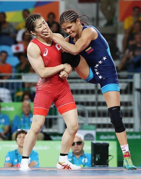 Japanese wrestler Saori Yoshida and Venezuela's Betzabeth Angelica Arguello…