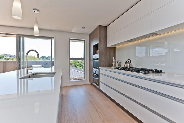 Clean long lines in this Kitchen, Melteca and lacquer contrasting cabinetry.