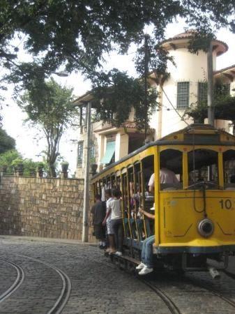 Brasil...  Bondinho no bairro de Santa Teresa, Rio De Janeiro, RJ.. O passeio que tem início na Carioca, passa sobre os Arcos da Lapa e sobe até Santa Teresa, descortinando lindas e bucólicas paisagens da cidade.