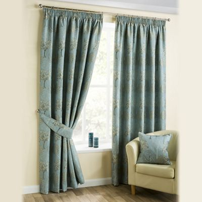 Pencil pleat curtains with a golden floral patterned set off on a duck egg blue background