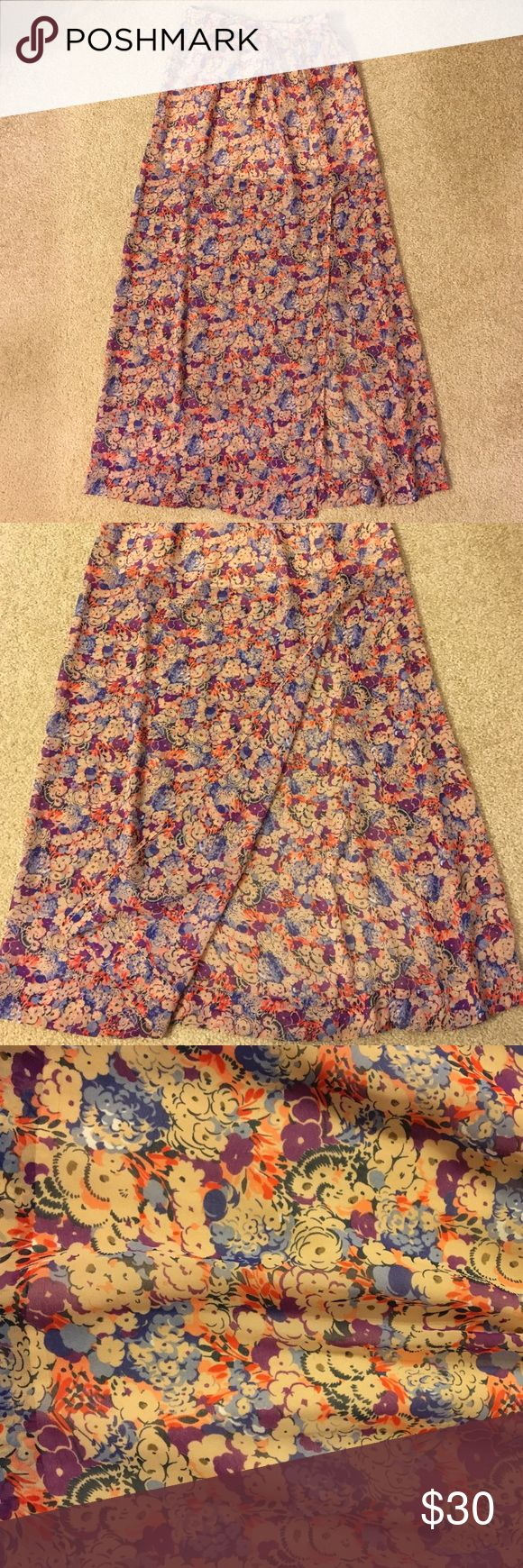 BCBGeneration skirt Floor-length floral skirt by BCBGeneration. Slit in the front goes all the way up the mid-thigh. Great condition. Last image is to show fit. BCBGeneration Skirts Maxi