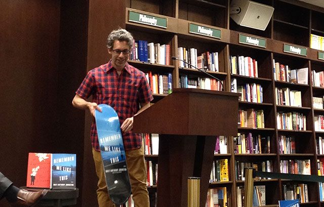 Bret Anthony Johnston shows of a skateboard painted like the cover of his novel, Remember Me Like This at the Upper West Side Barnes and Noble in Manhattan #BretAnthonyJohnston #RandomHouse #RememberMeLikeThis #Manhattan #B&N #NYC