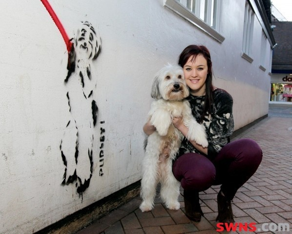 Ashleigh Butler and her dog Pudsey, winners of Britain's Got Talent 2012 next to a 'Banksy'  style street art tribute