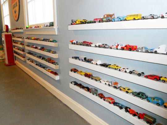 Picture Ledges: Interior Designer Lacey Carroll did a playroom makeover for a client whose son had lots of toy cars. She decided to display and store them using picture ledges.