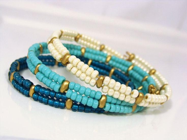 awesome DIY Bijoux - Super duo beads with regular beads on memory wire.  Has more possibilities....