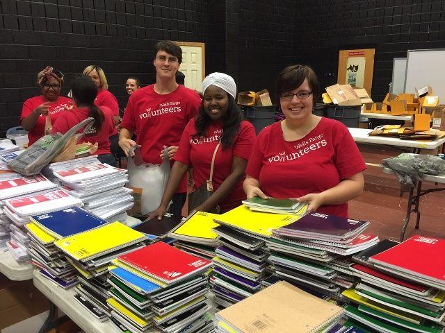 Wells Fargo employees sorting school supplies