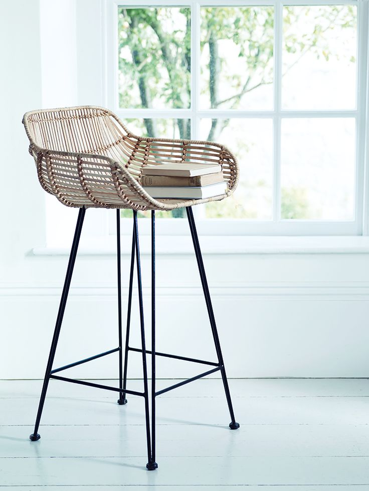 Inspired by classic 1950's design and material, our stylish high stool has a strong black iron frame and woven rattan in tonal shades of blonde. Our contemporary twist on this classic design has been especially designed for your comfort with a wide shaped seat, two low arms and foot rests. Team with our Rattan Armed Chair and Rattan Dining Chair for the complete look.