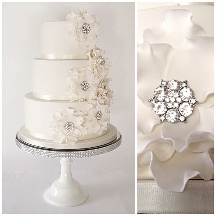 Crisp white wedding cake adorned with fantasy frilled flowers and diamanté's for that touch of sparkle.