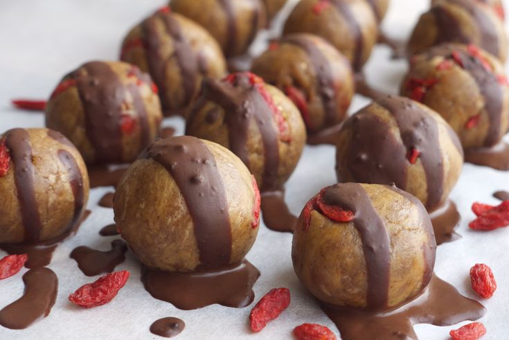 Peanut butter protein bites with dark chocolate drizzle