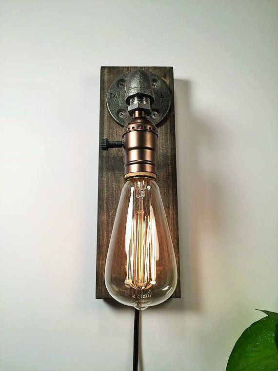 Industrial wall sconce, Rustic wall lighting, Steampunk pipe lamp, Vintage wall lamp, Classic Edison bulb INCLUDED, Wood base in weathere  ***Choose Socket Color & Edison Bulb Style***  ITEM DETAILS: -Measures 3 1/2W, 10H -Cord length 8F -Choose between silver or brass sockets (brass socket example can be viewed in pictures) -Classic 40 watt marconi filament Edison bulb included in purchase. -Wood base in weathered. -All electrical components are UL listed.  ADD ON: We offer a full range…