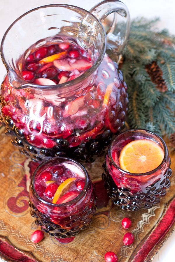 Christmas Sangria  This drink is cheerful, economical, and delicious. What's not to like? Make it the night before and your pitcher will be ready to display on your table for your guests the next day.