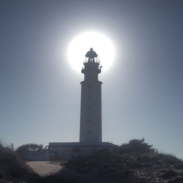 The sun behind Trafalgar light house, Costa de la Luz