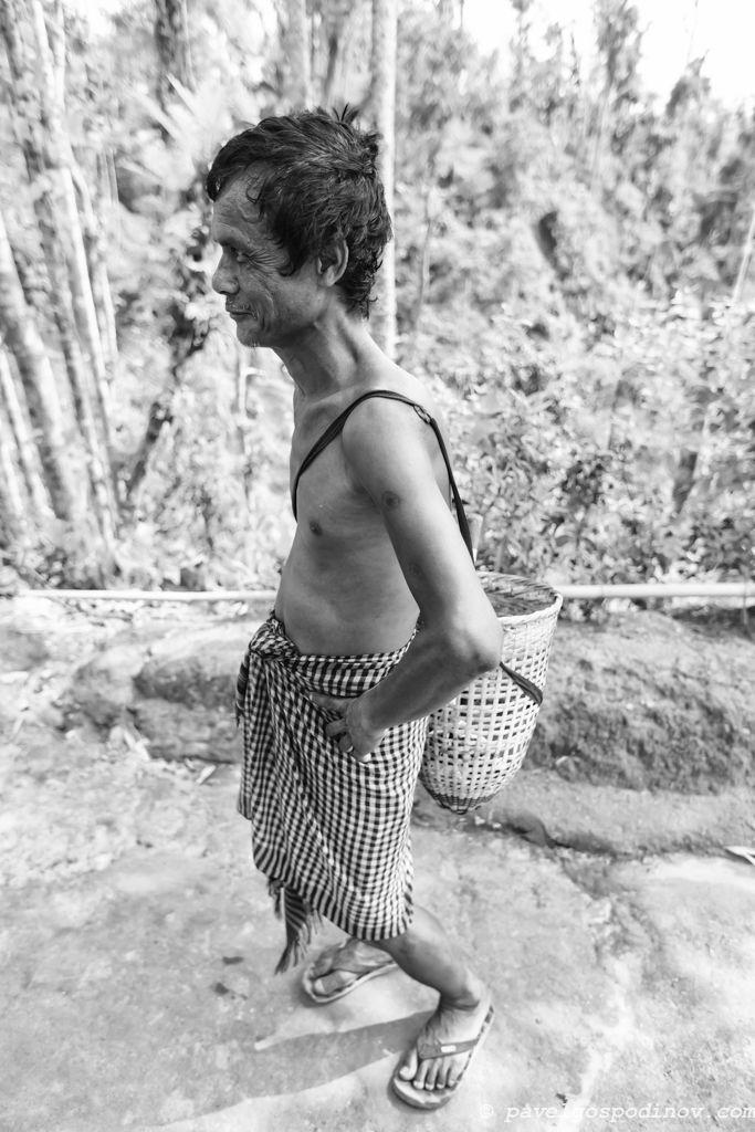 Khasi tribal man holding a basket with a strap on his shoulder, Khasi tribe,  Nirala Para (village), Sreemangal (Srimangal), Division of Sylhet, Bangladesh, Indian Sub-Continent, Asia