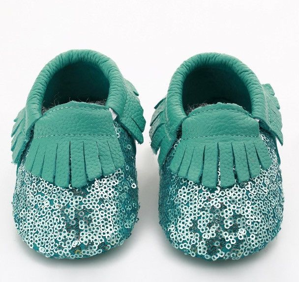 These sequin leather moccs are just absolutely adorable. Great for any special occasion or everyday use. They are fitted with an elastic around the ankle to help keep the shoe snug and on while your b