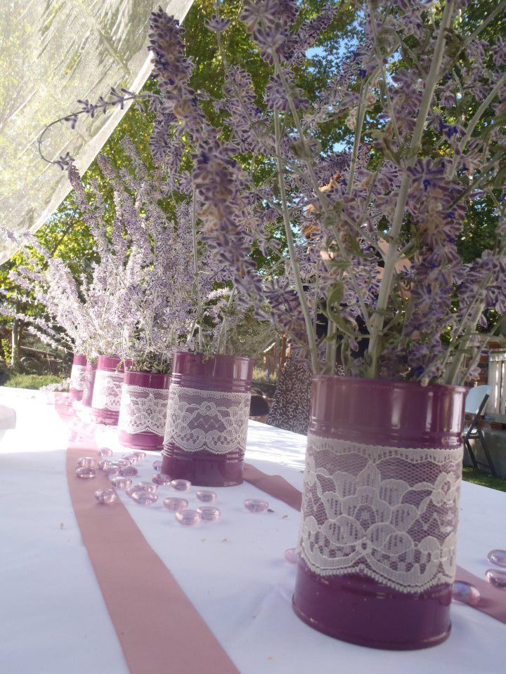 Perfectly simple decor- just tin cans, spray paint, and lace!
