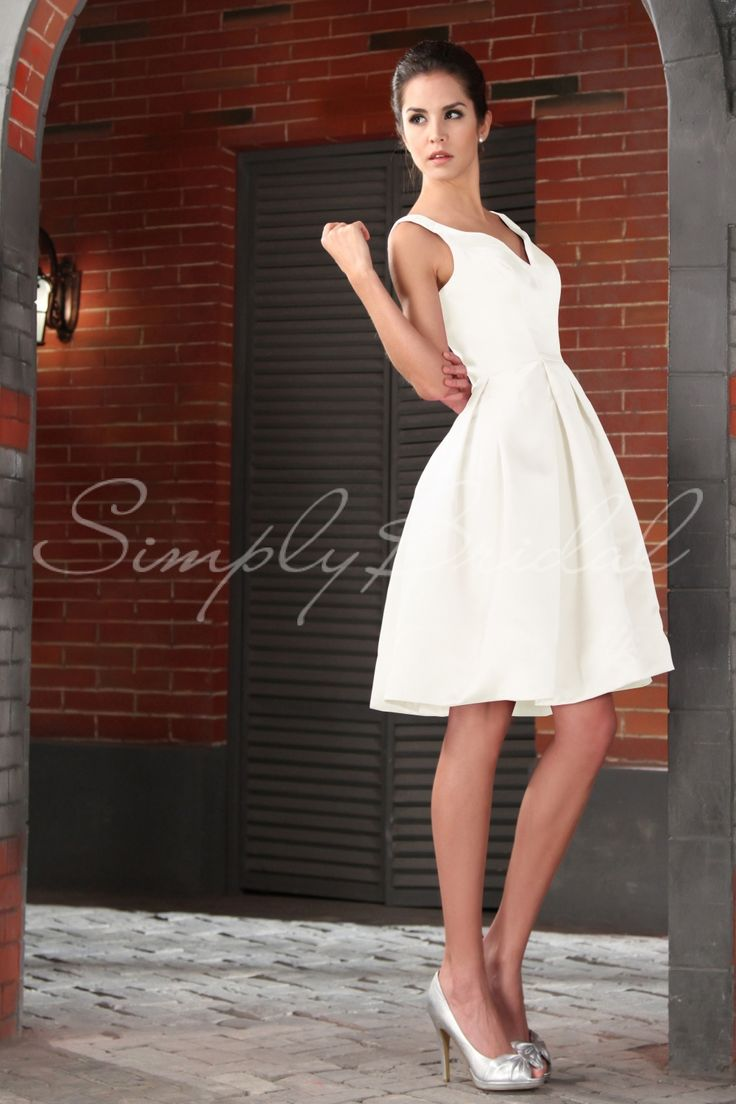 This wedding gown has a deep V in the front and back and made of luxurious satin. Simple but beautiful.
