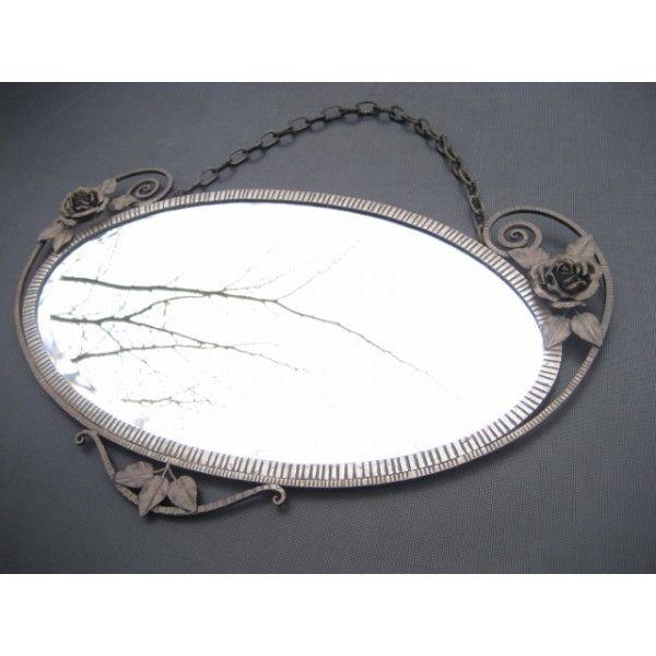 Art Deco spiegel met geslepen glas en stalen lijst Art Deco mirror with beveled glass and steel frame