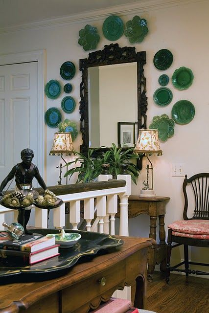 love the green plates on the wall and all the small details of this hall.
