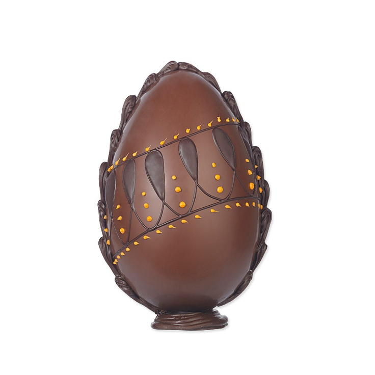 Bettys Milk Chocolate & Orange Easter Egg | A handmade Swiss milk chocolate egg, delicately flavoured with fragrant orange oil and beautifully decorated with hand-piped dark and orange white chocolate in a vintage-inspired pattern.