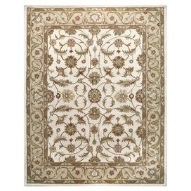 Hand-tufted wool rug with a floral motif.  Product: RugConstruction Material: WoolColor: IvoryFeatures: Hand-tuftedNote:  Please be aware that actual colors may vary from those shown on your screen. Accent rugs may also not show the entire pattern that the corresponding area rugs have.Cleaning and Care: Regular vacuuming and spot cleaning recommended