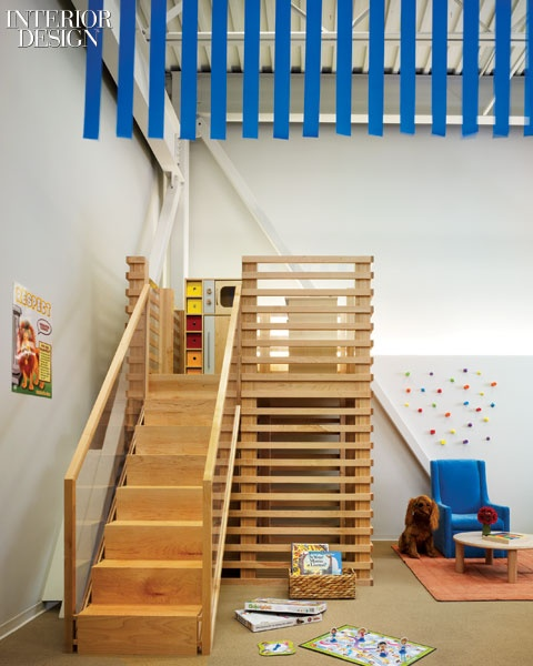 Classrooms each have a maple loft play area and strips of grosgrain ribbon hanging down from the exposed ceiling joists.