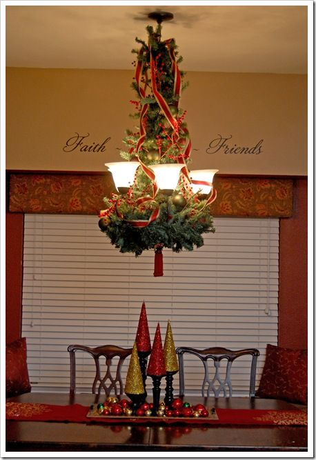 red & gold ribbon and curled it down the sides of the garland, kinda like I would do on a Christmas tree. Once that was in place, I filled in the gaps with some ornaments & berries & then attached a fun & frivolous tassel