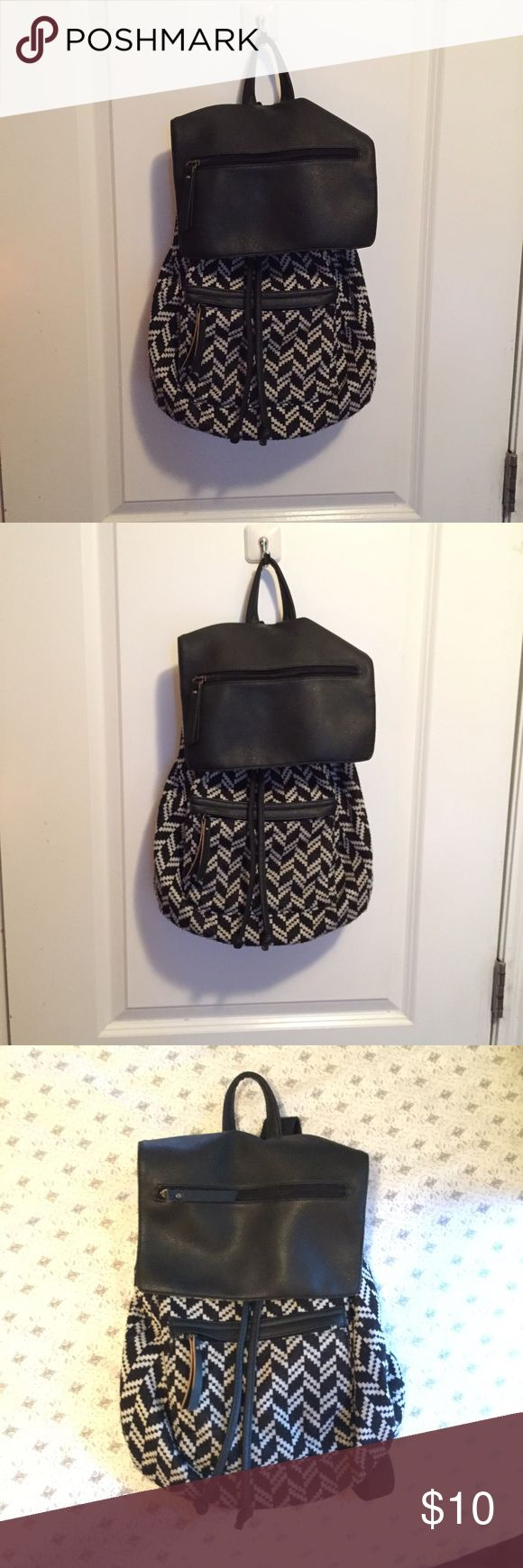 Madden Girl Festival Book Bag Madden Girl Festival Book Bag Has many pockets for all your things and a drawstring closure So cute for carrying small things with you comfortably and in style  Wore this for Lollapalooza last year ✌🏽✌🏽✌🏽 Front pocket, pocket on the front flap, small zipper pocket in main compartment  Cute tribal black and gray pattern ***flaw: the flap closes on with a magnetic snap the bottom portion this is coming loose & separating from the bag (you can still close the…