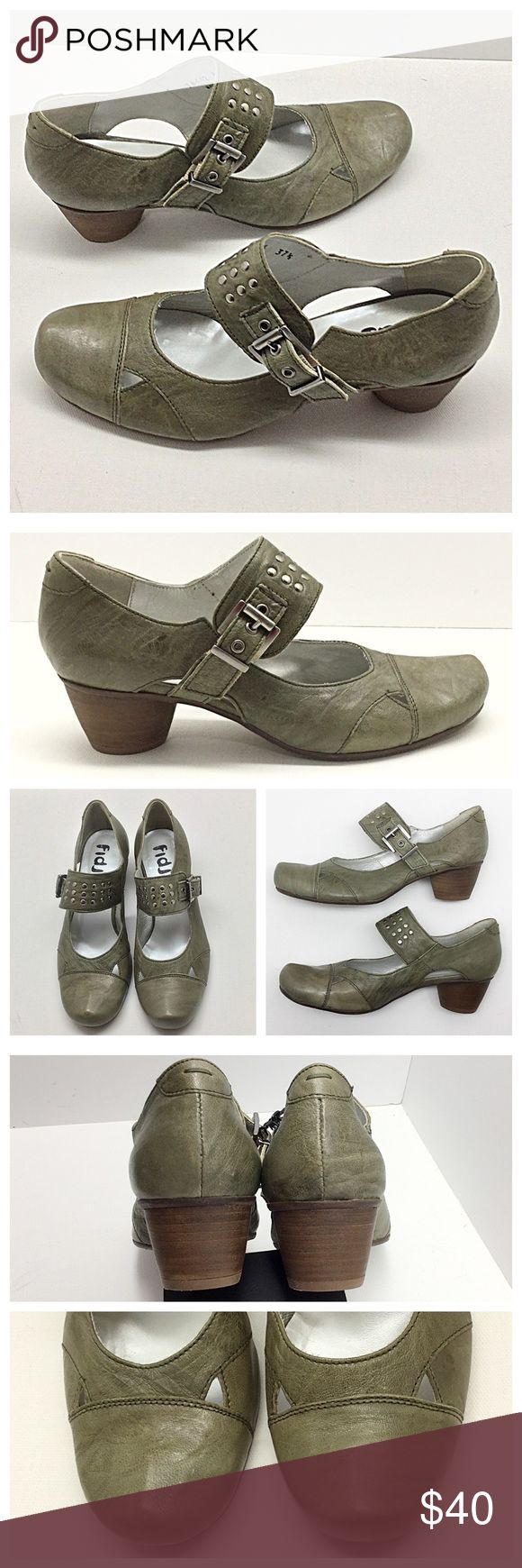 "Fidji Studded Mary Janes 🚫Trades/Holds🚫 Fidji Heels *  Distressed light olive green leather *  Top buckle w/ silver studs *  1 1/2"" round, stacked heel *  Size 37 1/2, true to size IMO *  Pre-loved, heels are excellent - very little wear, leather is supposed to look distressed so it has tonal color variation, a slightly darker spot on one side (pic 4, bottom right) Plz ask ?s if unsure of condition or need more pics! Fidji Shoes Heels"