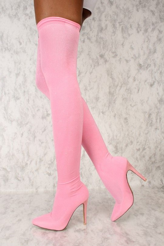 6cb31b405d21 These AMI boots will have you looking like never before! Features include,  a stretchy nylon fabric, pointy toe, thigh high, and a cushioned foot bed.