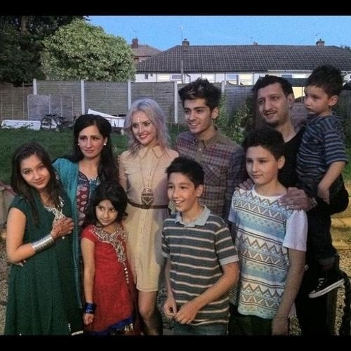 Zayn, Perrie, and his family. aww, already taking her to meet his parents<3