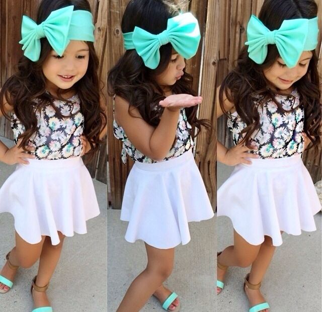 This is so adorable. Little girl: white circle skirt, print top, mint bow headband mint sandals.
