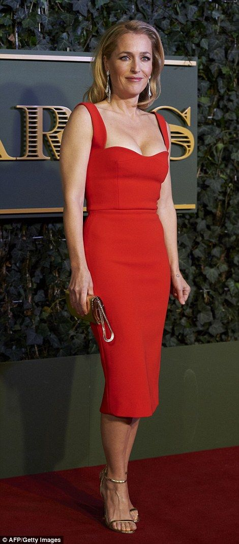 The Fall star Gillian Anderson looked svelte and sophisticated in unseasonable low cut dre...