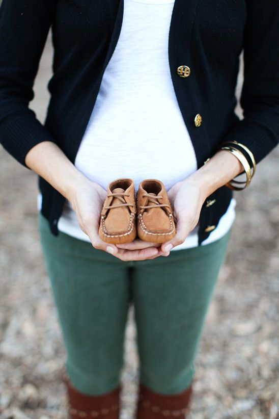 Bring a pair of shoes you plan on putting on your little one. Then take a picture of them wearing the shoes when they are big enough to do so.