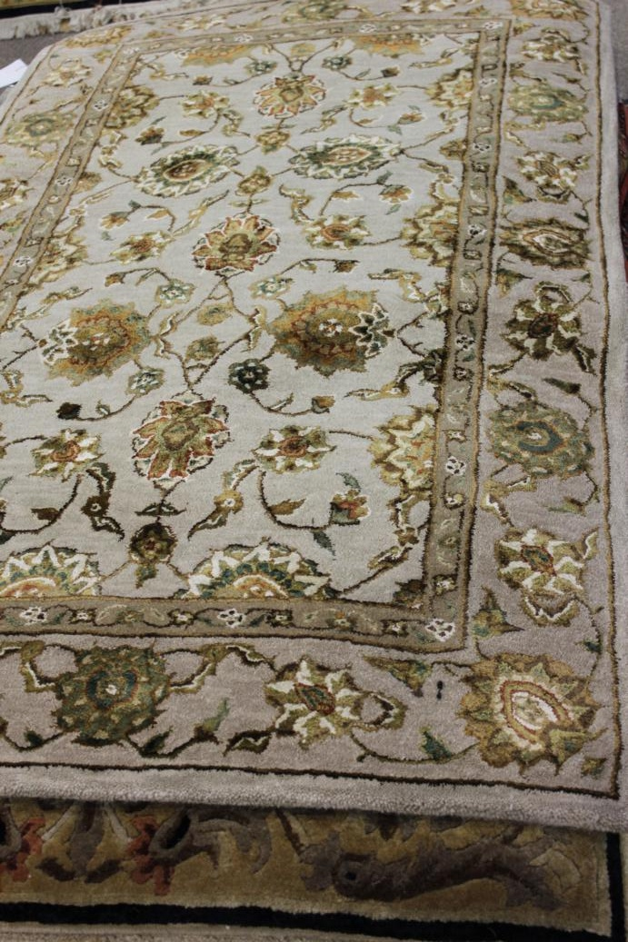add beauty and warmth to any room with a large area rug