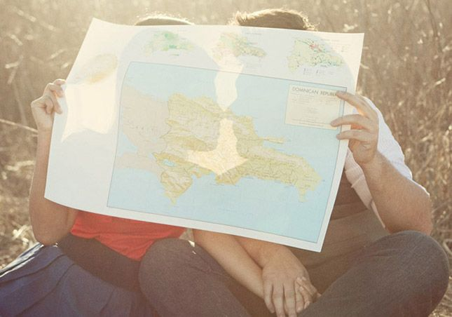 Almost missing behind a map or other meaningful paper? 20 Creative + Gorgeous Summer Engagement Photo Ideas via Brit + Co.
