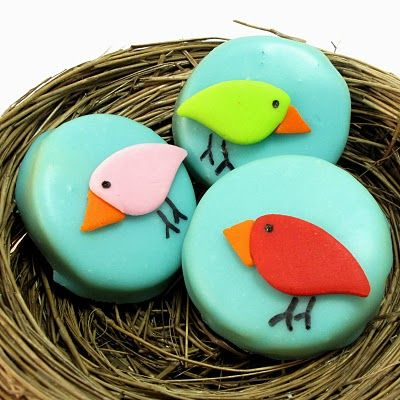 "cute birdie cookies, but more importantly, a recipe for ""poured sugar icing"", which is the smooth blue icing on these cookies."