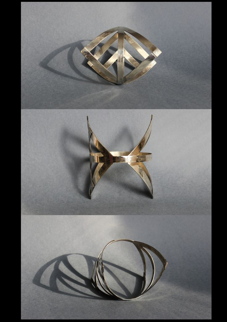 """Bracelet made from white brass with silver rivets.  """"Sixth bindrune is the final piece in the collection. The old form was replaced by a modern, defined lines and straight edges. White color with matt silver evolved in a smooth shiny surface of alpaca. The arms of the runes are connected with silver rivets, as the achievements of modernity is linked to past values.""""  Meanings behind the bracelet: #courage and #protection"""