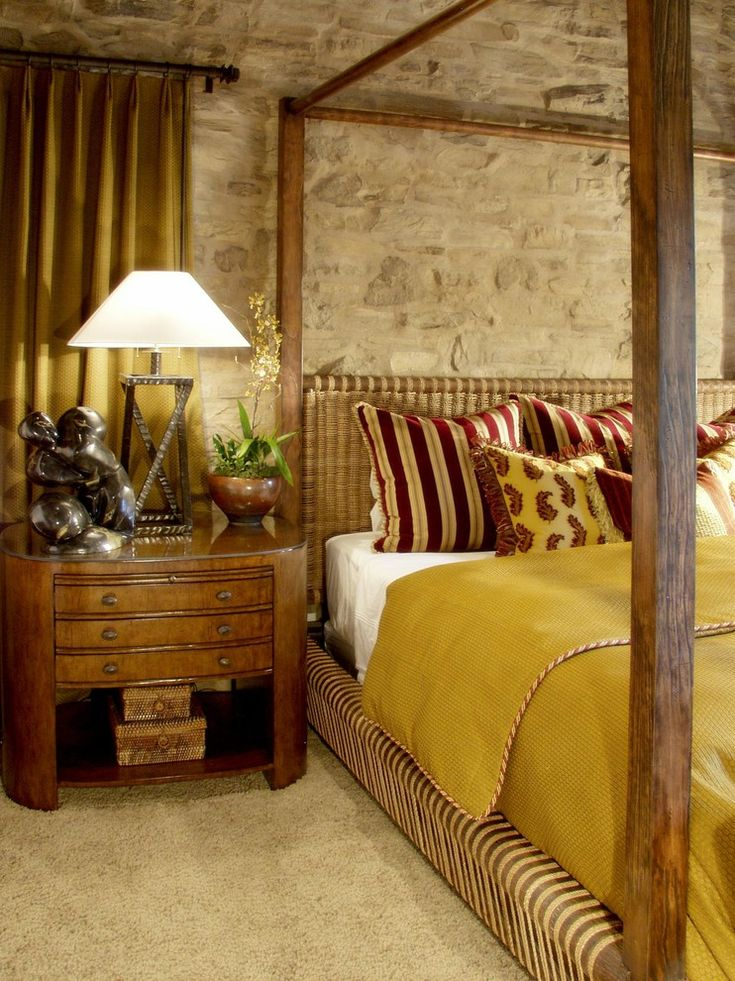 Stone accent wall bedroom mediterranean image ideas with striped pillows mustard bedding