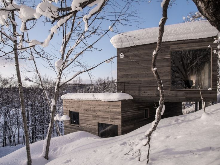This beautiful vacation house has been built byFlorian Busch ArchitectsinNiseko, Japan. It is perched on a sloping lot overlookingMount Yotei. Two blocks of the building are shifted in a perfect way to accommodate this challenging landscape. The structure is reinforced by a concrete shear walland covered with light wood on the outside.