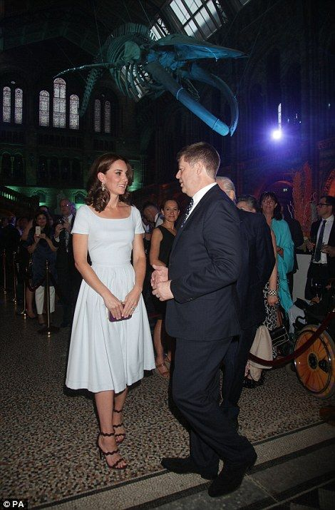 The Duchess of Cambridge talks to museum director Sir Michael Dixon