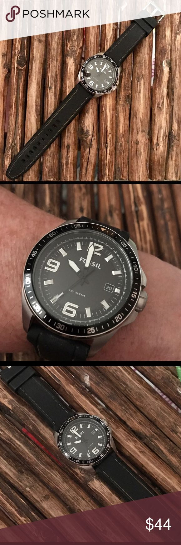 Men's Fossil Watch Black rubber/silicone band with stainless case. Watch face is black with white numbers & hands. EUC! Very minimal scratches on the back and sides of the case from normal wear. NO scratches on the crystal. Needs new battery. Fossil Accessories Watches