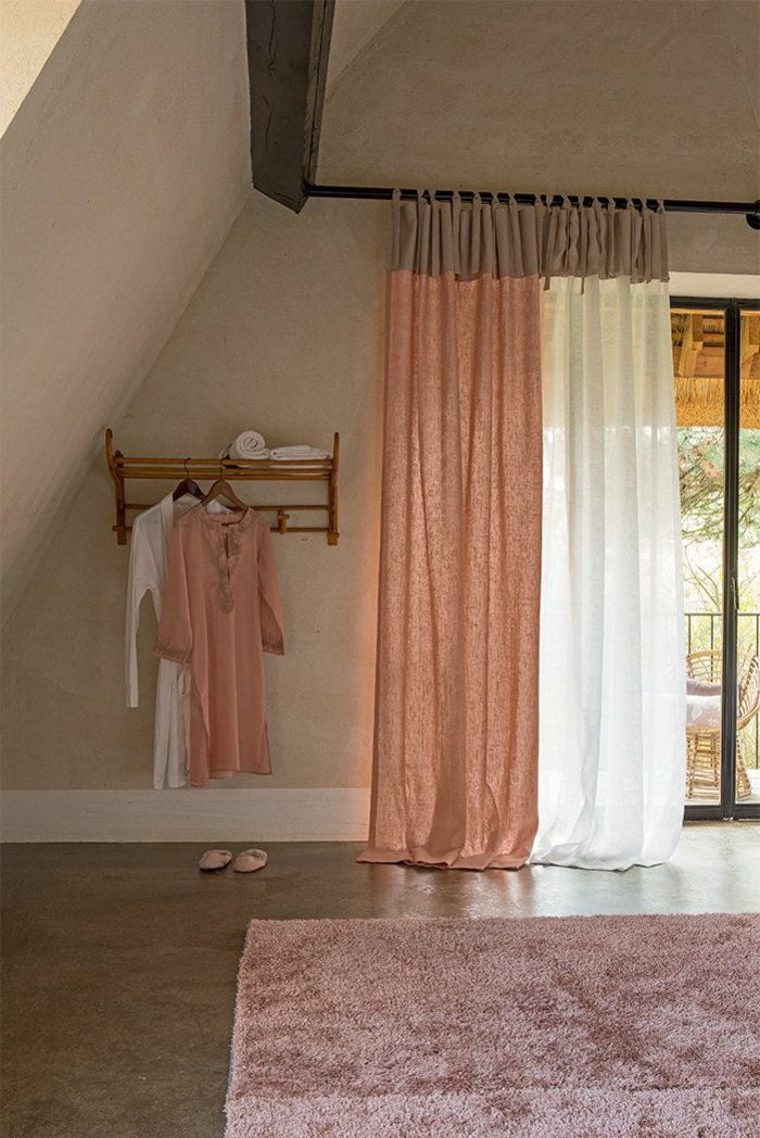 Curtain in pink and white linen, pink carpet, superb atmosphere